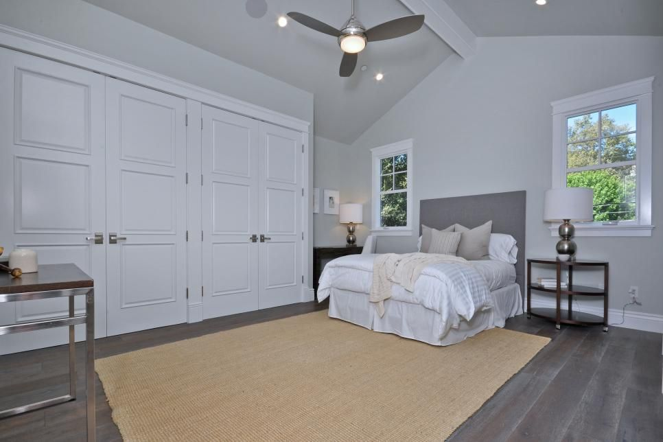 This contemporary bedroom is decorated in gray and white ...