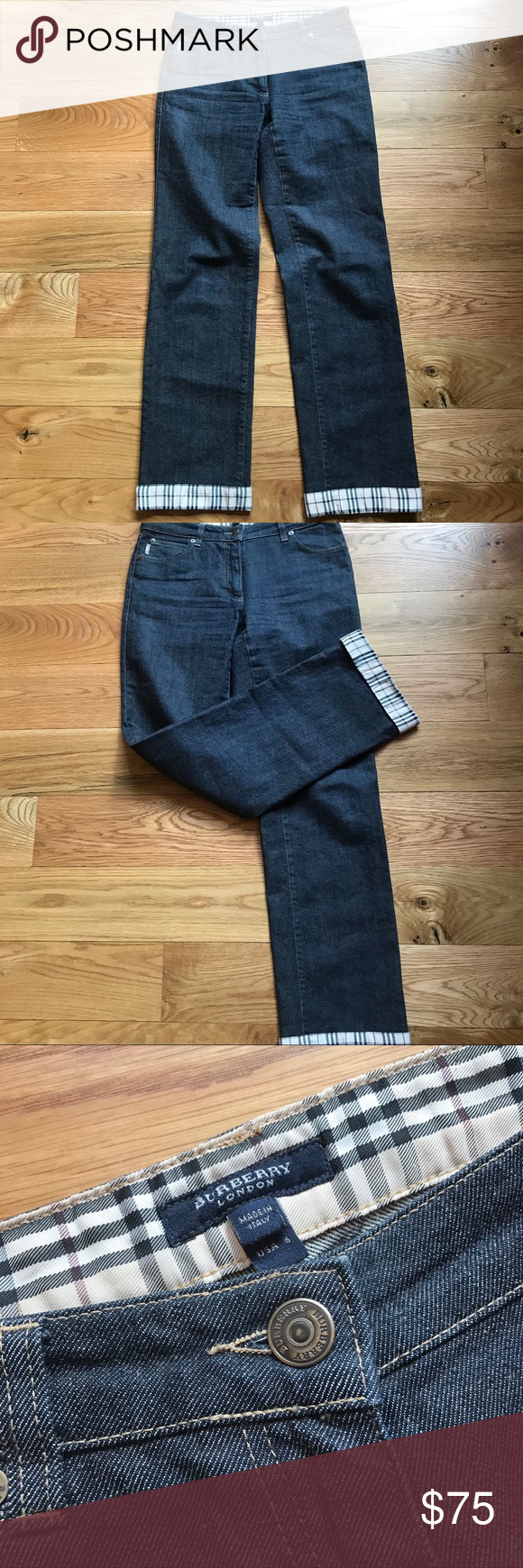 """BURBERRY LONDON NOVA CHECK CUFF JEANS Turned up cuff show off the signature Burberry fabric in these dark indigo blue straight leg jeans. In new condition. Size 6. Approx measures 14"""" waist, 8.5"""" rise and 31"""" inseam. Burberry Jeans Straight Leg"""