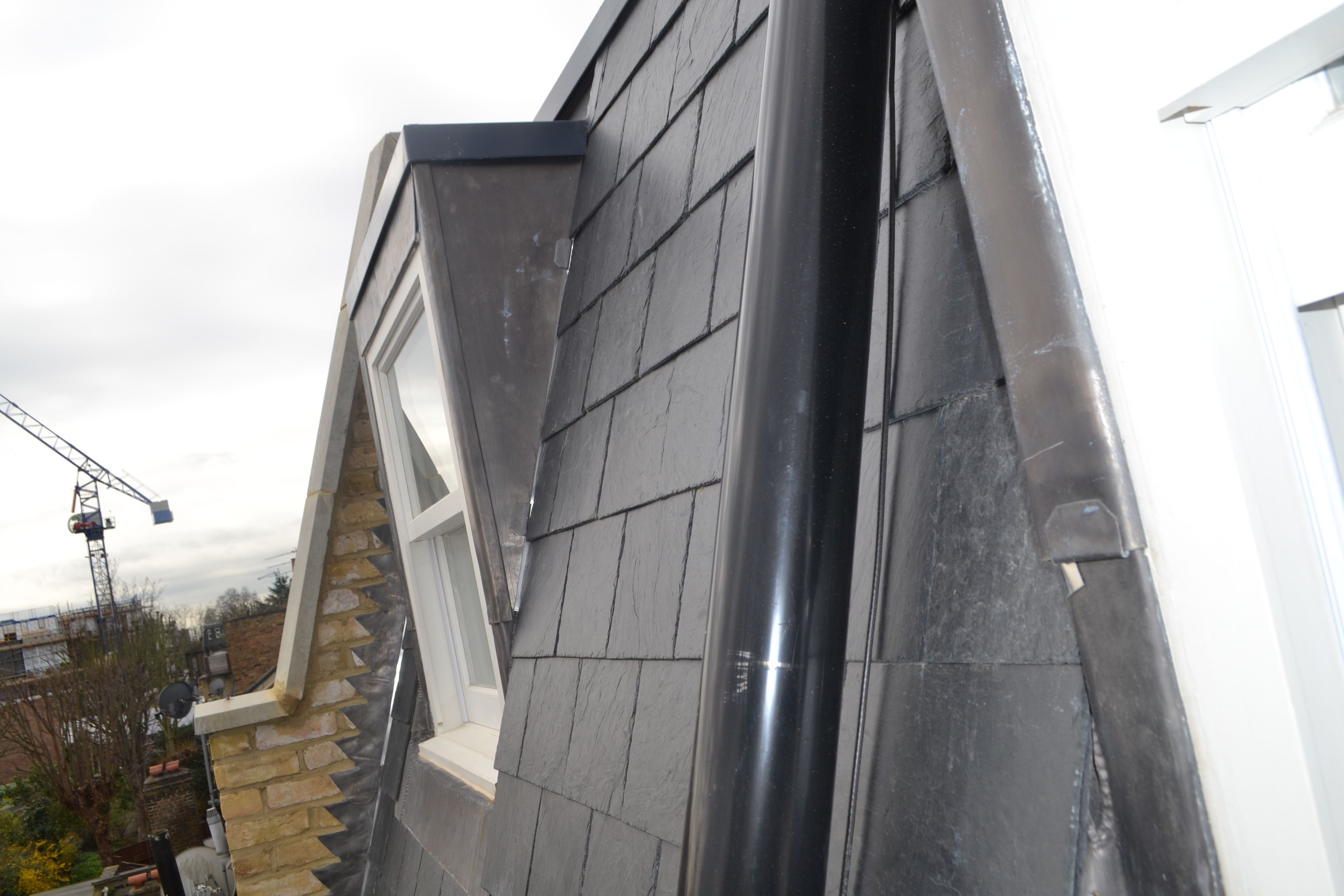 Mansard Loft Extension With Grey Slate Tiles White Pvc Fascia Black Pvc Guttering And High Performance 3 Layer F Roof Architecture Modern Roofing Roof Styles