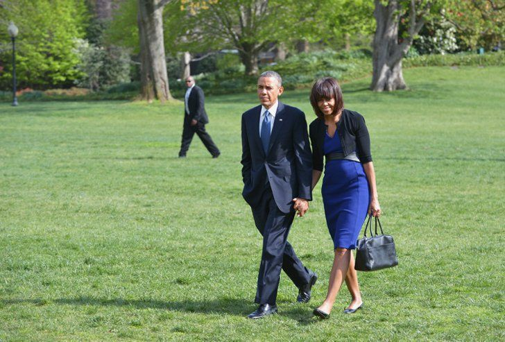 Pin for Later: Michelle Obama's Latest Look Is Much More Than Just a Pretty Dress  President Obama and Michelle Obama stepped out together in matching shades of blue in mid-April.