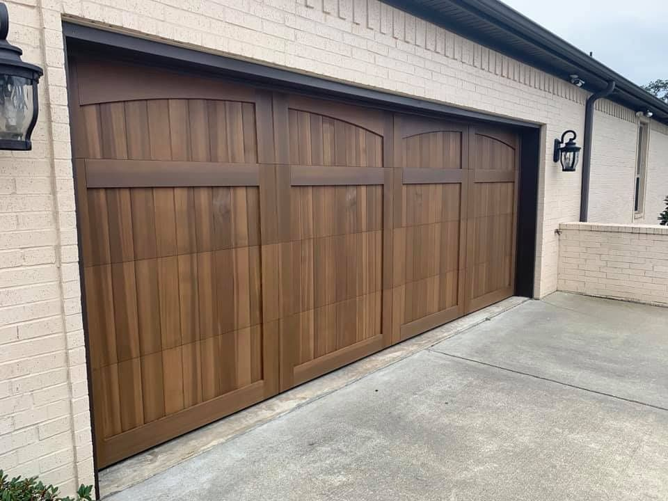 Handcrafted Overlays Of Clear Red Cedar Can Be Stained To Enhance The Richly Grained Wood S Beauty And Ma Garage Doors Homestead Style Residential Garage Doors
