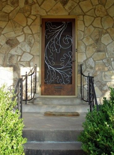 """Encina""_this native texas stone cottage is nestled under a canopy of oaks.  With its deep front porch and hillside approach, it was just screaming for this leaf inspired design."
