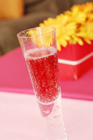 Spring 2014 Cocktail: Pomegranate Champagne-Punch- the white rum gives it some zest