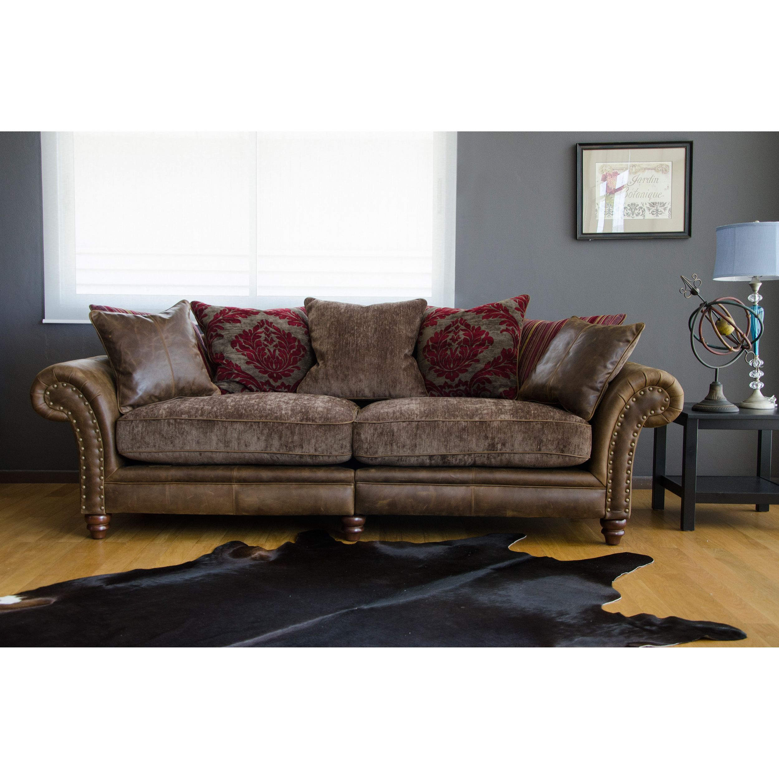 This Hudson leather sofa features deep seating and soft feather pillows for  maximum comfort. Perfect