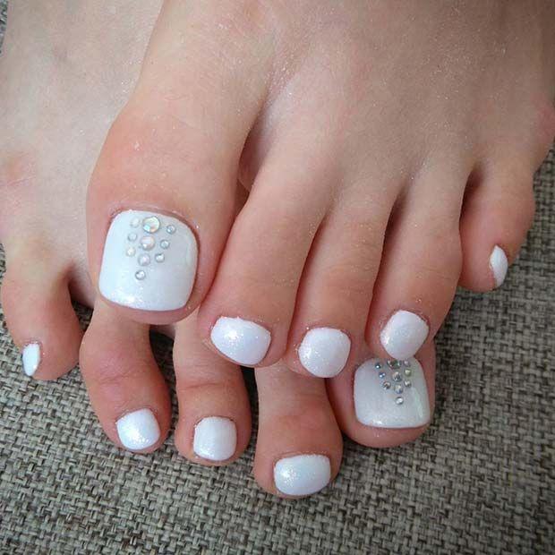 simple white pedicure with rhinestones