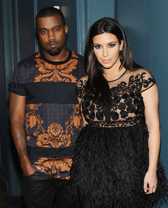 Kardashian and West were complete opposites in the fashion department at the Givenchy fall/winter 2013 ready-to-wear show in Paris, France.