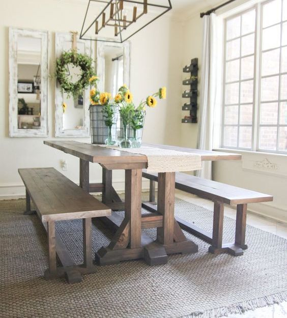 A Simple Rustic Dining Space With A Trestle Dining Table And - Pottery barn trestle dining table
