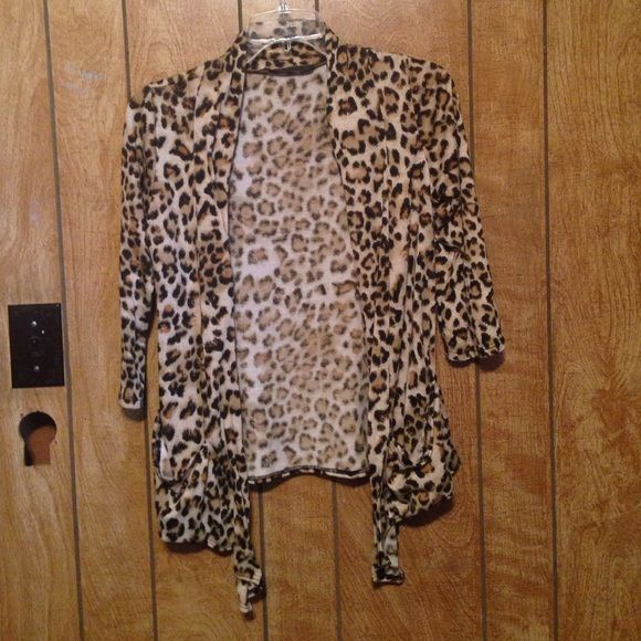 Leopard print cardigan Great condition. Only worn a few times. No flaws that I have seen. Has 2 pockets in front and is longer on the sides. No size tag but it fits a small or medium Sweaters Cardigans