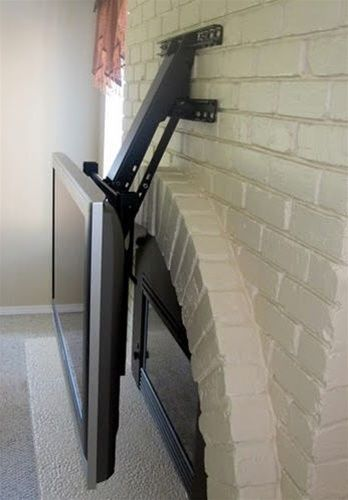 fireplace tv mount extends out and swings downward 30 home improvement projects pinterest. Black Bedroom Furniture Sets. Home Design Ideas