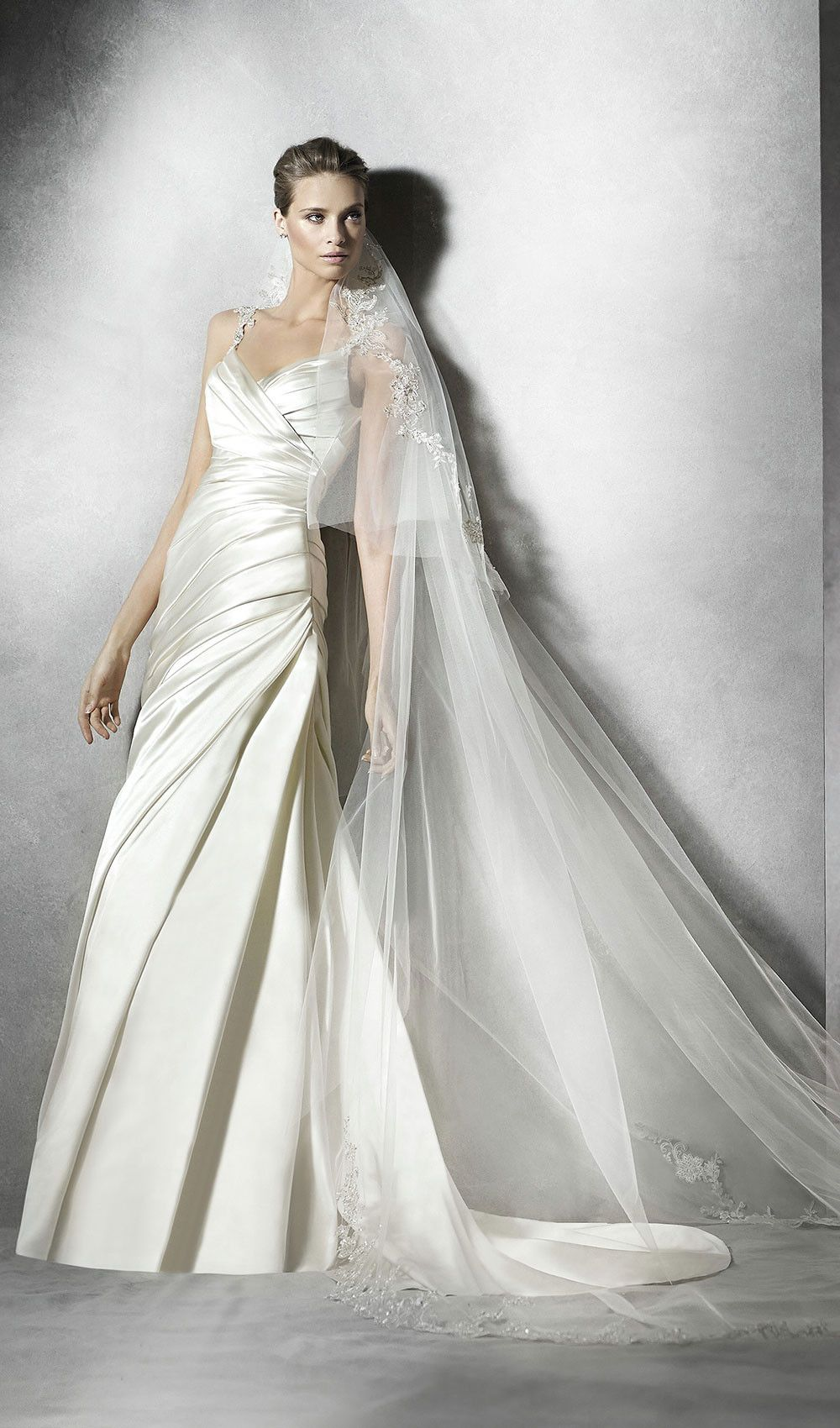 Try this flared wedding dress in draped satin draped bodice with