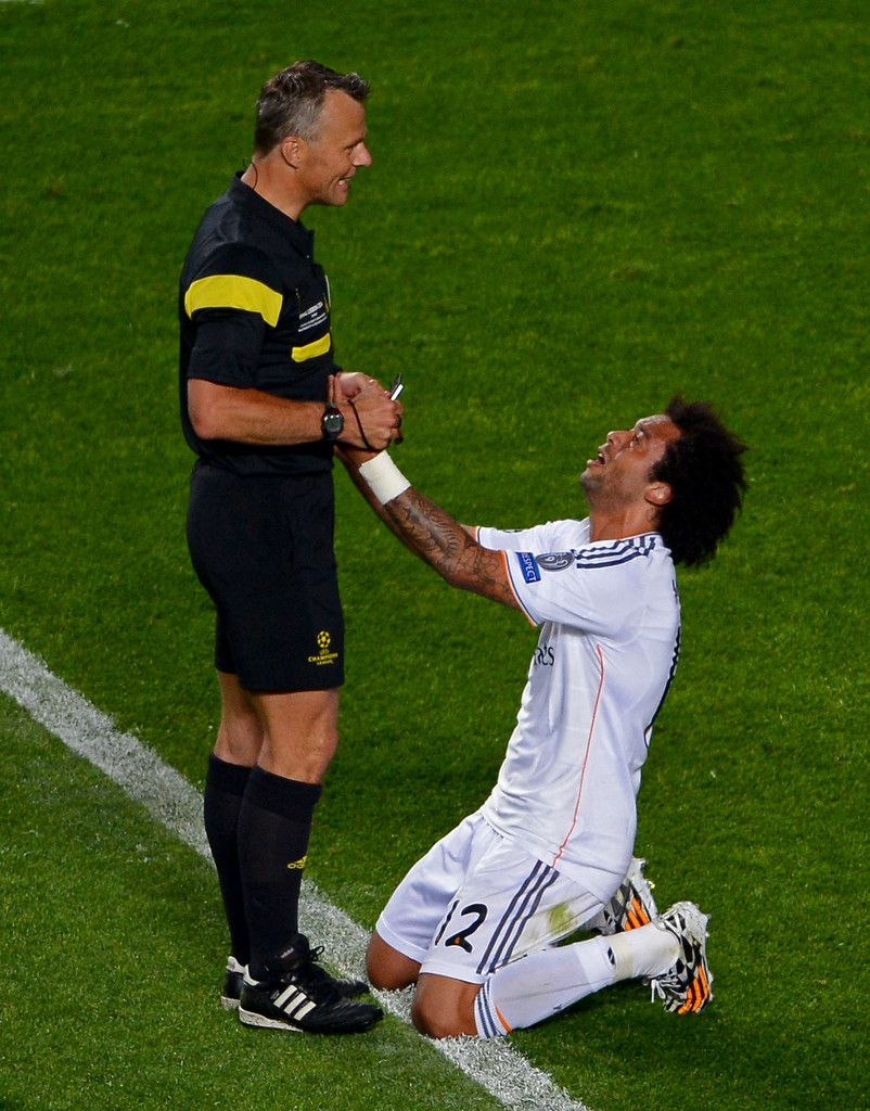 Marcelo appeals to referee Bjorn Kuipers during the UEFA Champions League final match between Real Madrid CF and Club Atlético de Madrid at Estadio Da Luz on May 24, 2014 in Lisbon, Portugal.