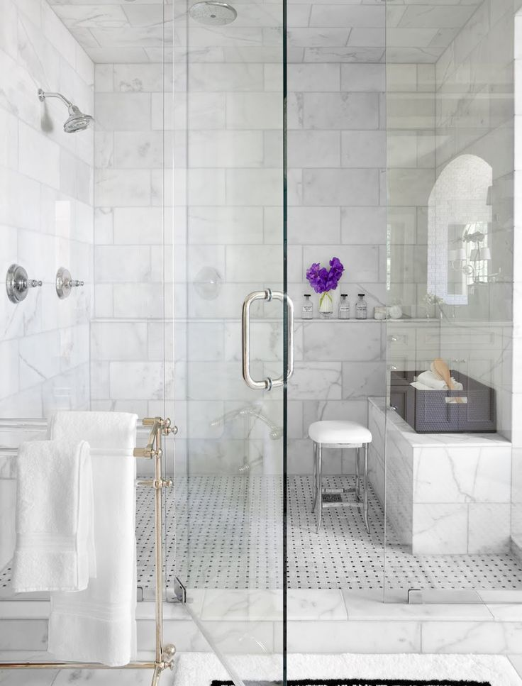 Beautiful white marble bathroom design inspiration with glass door and perforated flooring also small chair netnoot