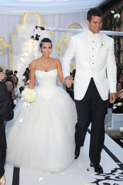 On Our List Of Most Extravagant Celebrity Weddings The Kim Kardashian And Kris Humphries Wedding Top Wedding Dresses Kim Kardashian Wedding Kardashian Wedding