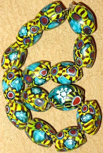 Rare antique Venetian made aqua millefiori oval beads with multiple murine cane patterns collected from Africa.