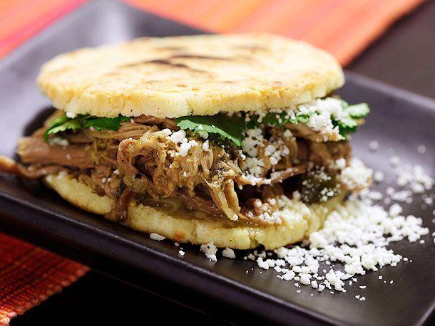 Arepas Rumberas (Venezuelan-style Arepas with Pulled Pork), SeriousEats (oil, pork shoulder, onion, garlic, poblano/hatch chili, chicken broth, bay leaves, queso fresco/cotija, cilantro, arepas [link to recipe])