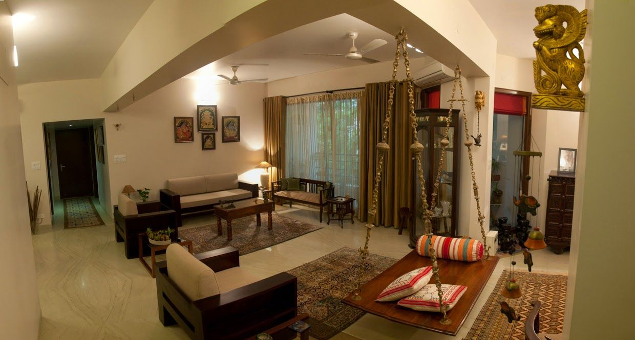 Traditional indian homes with a swing traditional indian for Living room interior design ideas india
