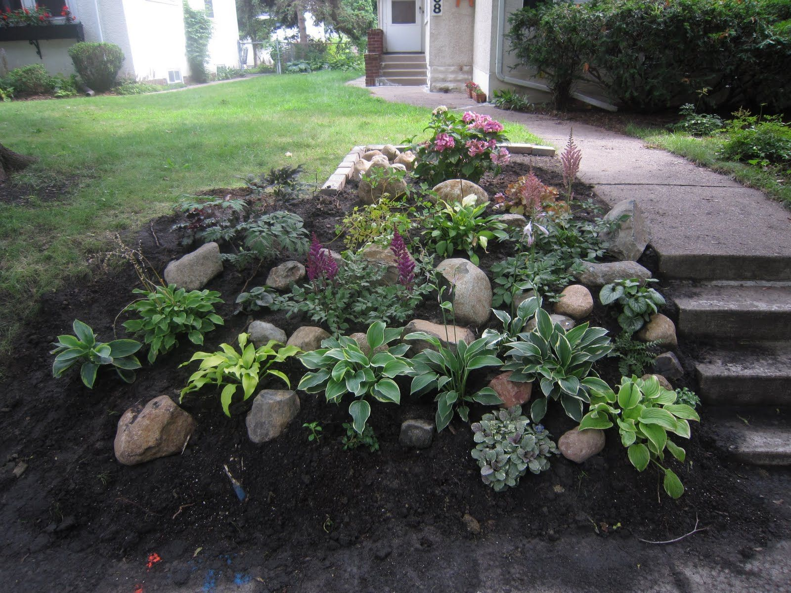 Backyard slope ideas see the plants i used here for Landscaping rocks and plants