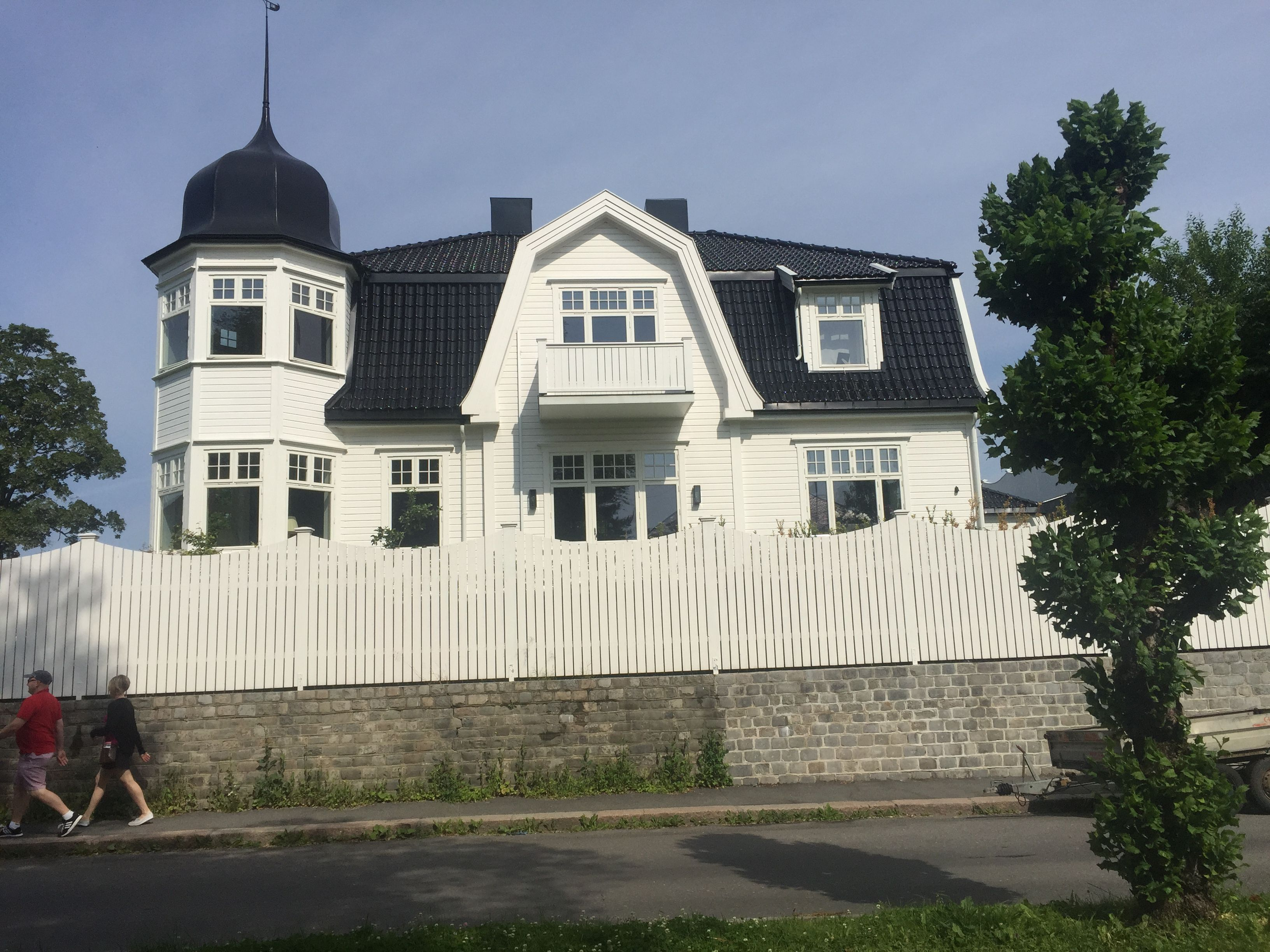 Beautiful example of Norwegian home design. Love the white paint ...