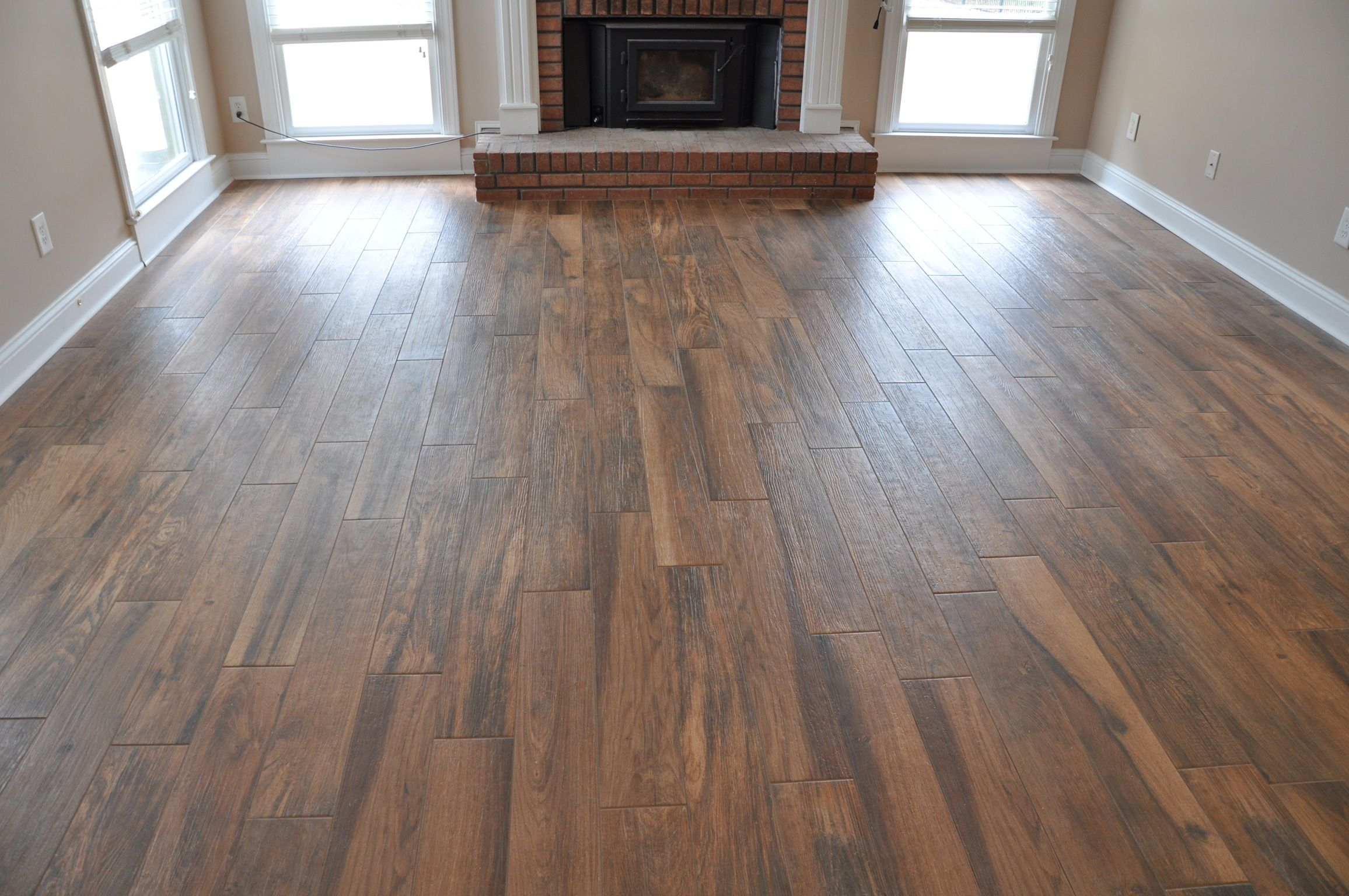 Wood look porcelain tile google search flooring for Tile and hardwood floor