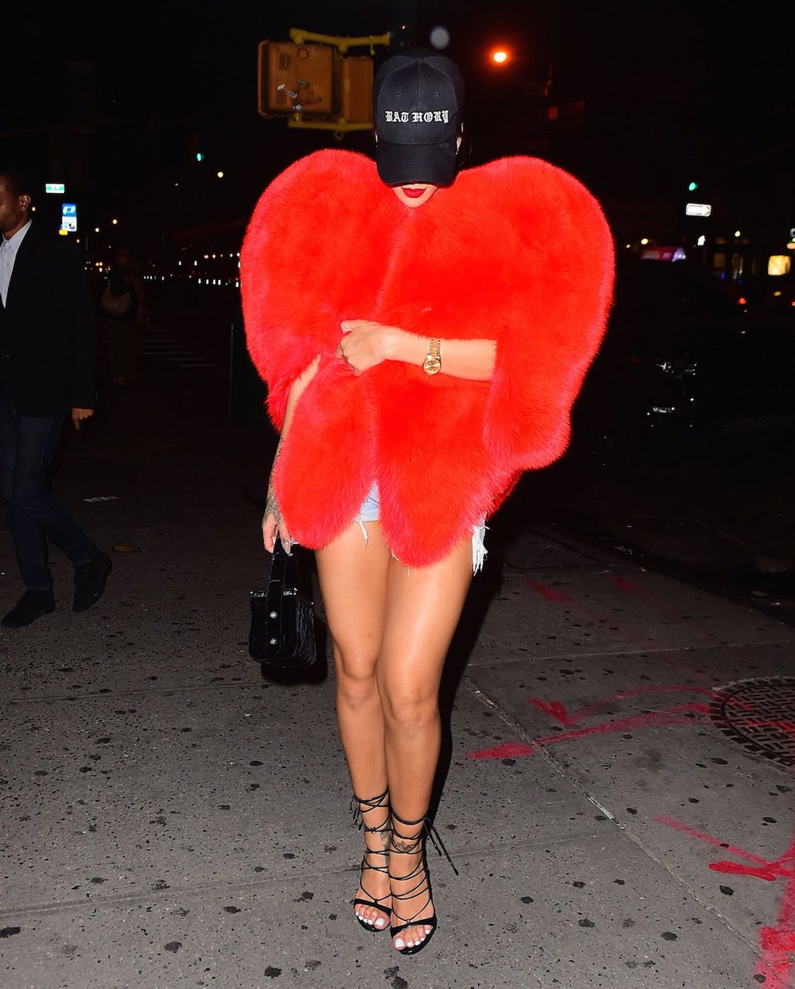 Rihanna was spotted in the streets of New York wearing a Saint Laurent heart-shaped fur cape. Get more outfit info @ http://bit.ly/2cB7Jo3