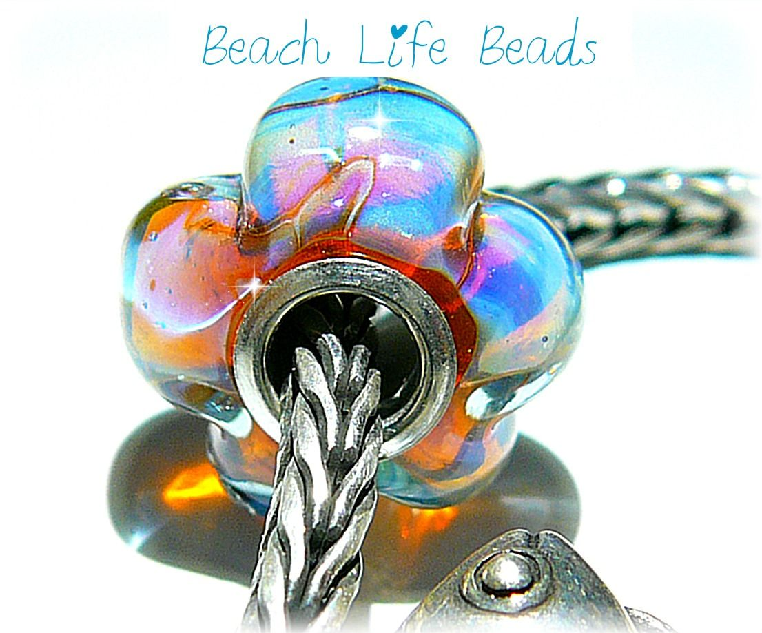 Beach Blossom Opal Handmade Glass bead fits Troll and Pandora bracelets. New beads will be posted to my Facebook business page this week. https://www.facebook.com/BeachLifeBeads?ref_type=bookmark