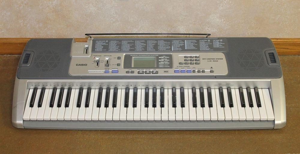 Casio LK-100 Electronic Keyboard/Piano 61 Key 50 Rhythm Key