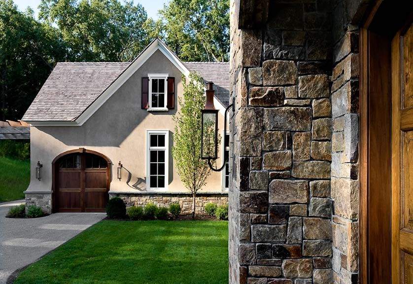 Image stone and brick exterior french country home for Stucco stone exterior designs