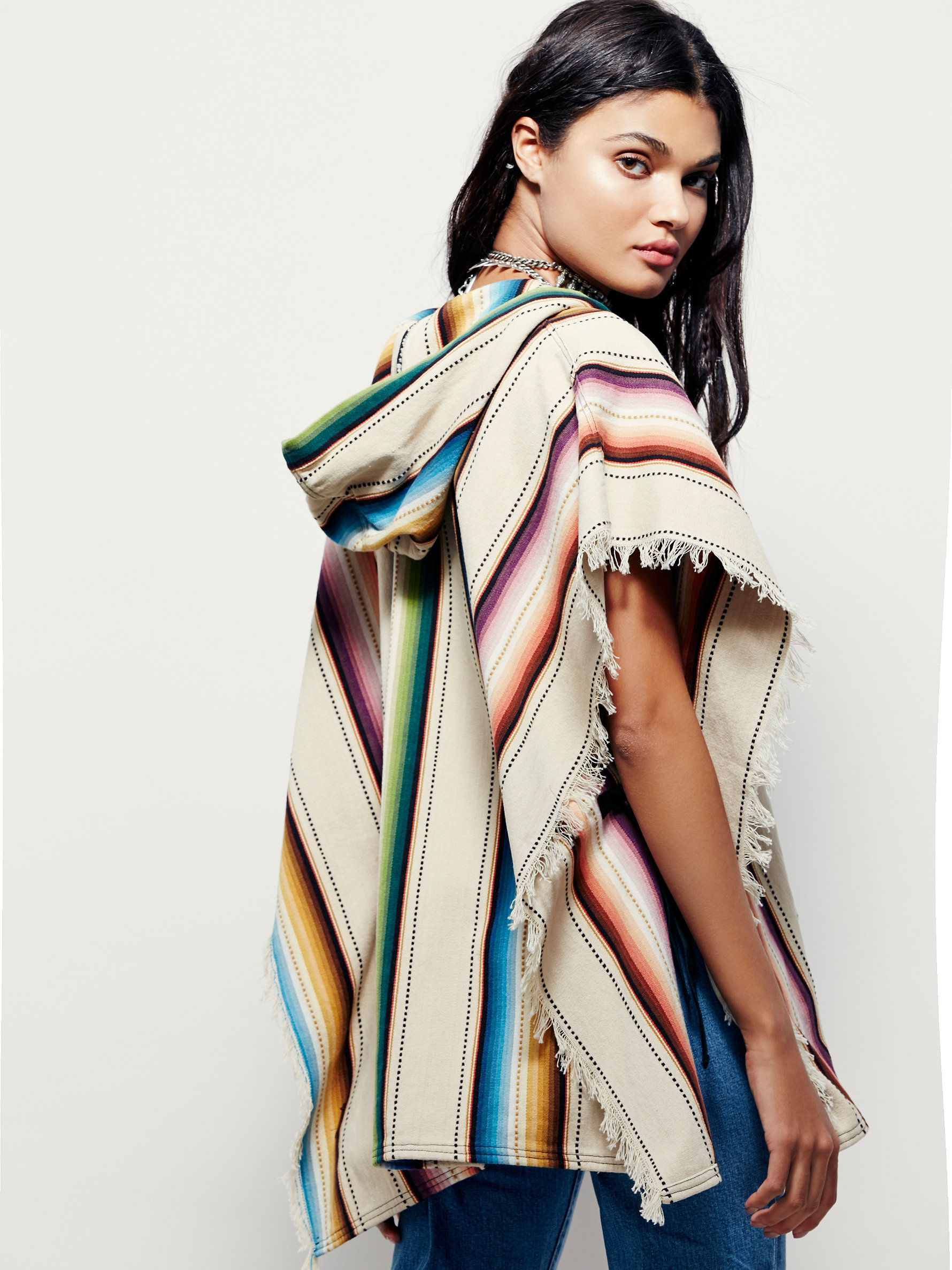 Jen's Pirate Booty Mountain Jam Poncho | In a tribal-inspired print, this American made hooded poncho features fringed trim and a front kangaroo pocket. Tie closures on the open sides.