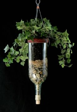 Wine bottle hanging Planters, use coffee filter between layers so earth doesn't seep down and keeps a clean look.
