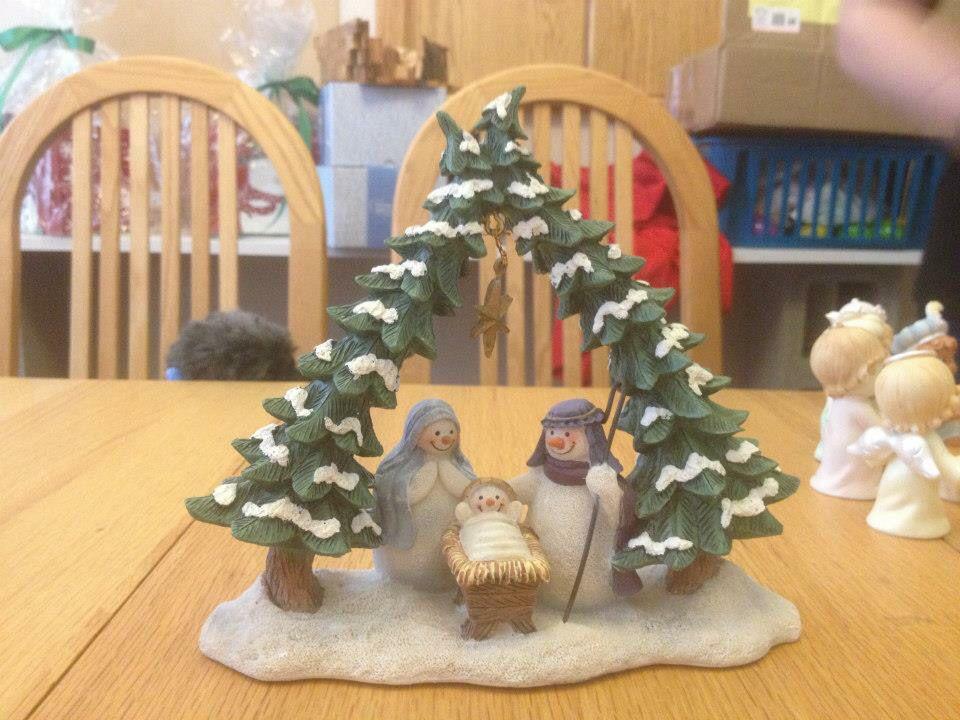 Snowman nativity under Christmas tree stable