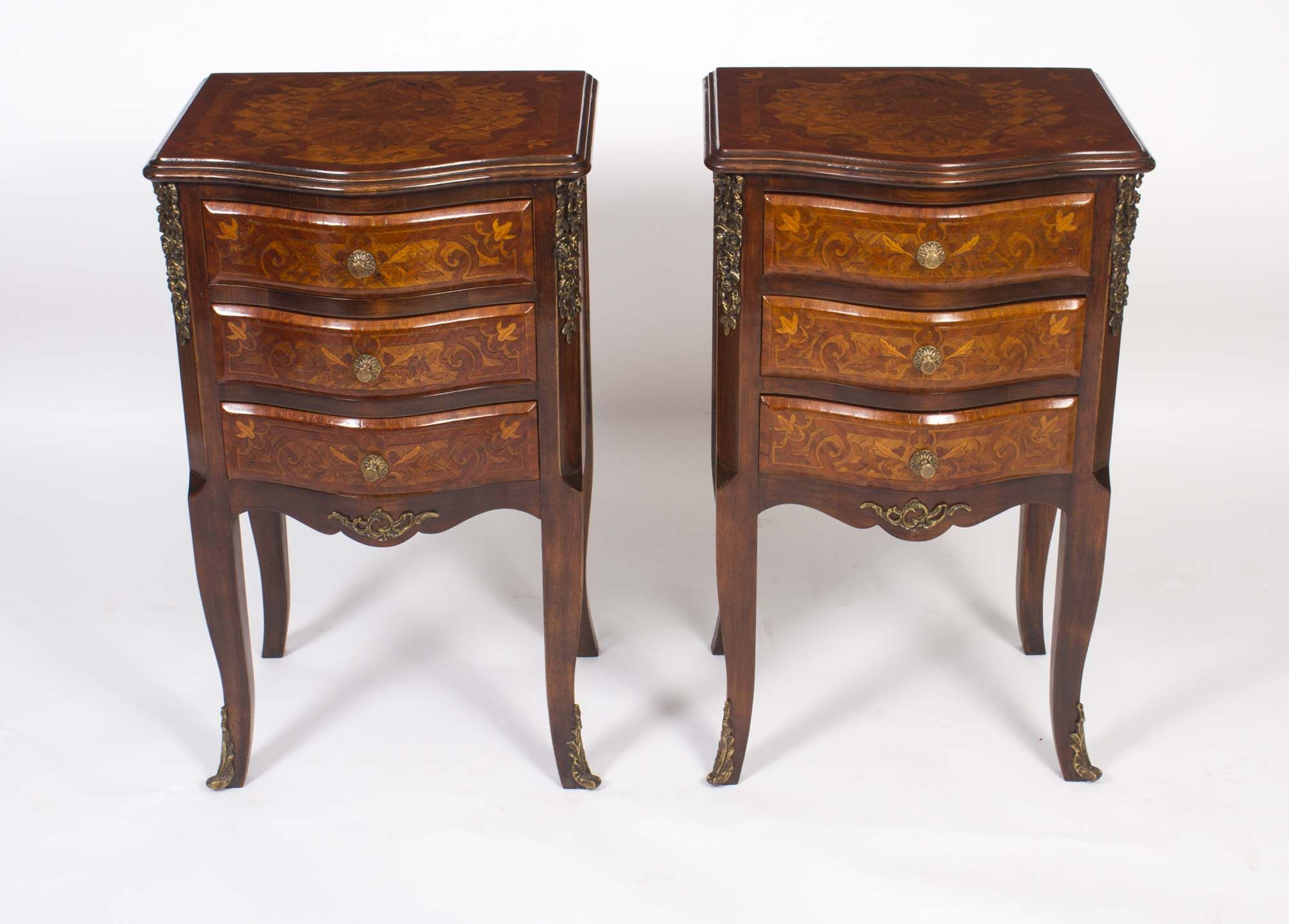 A vintage pair of French marquetry bedside cabinets.
