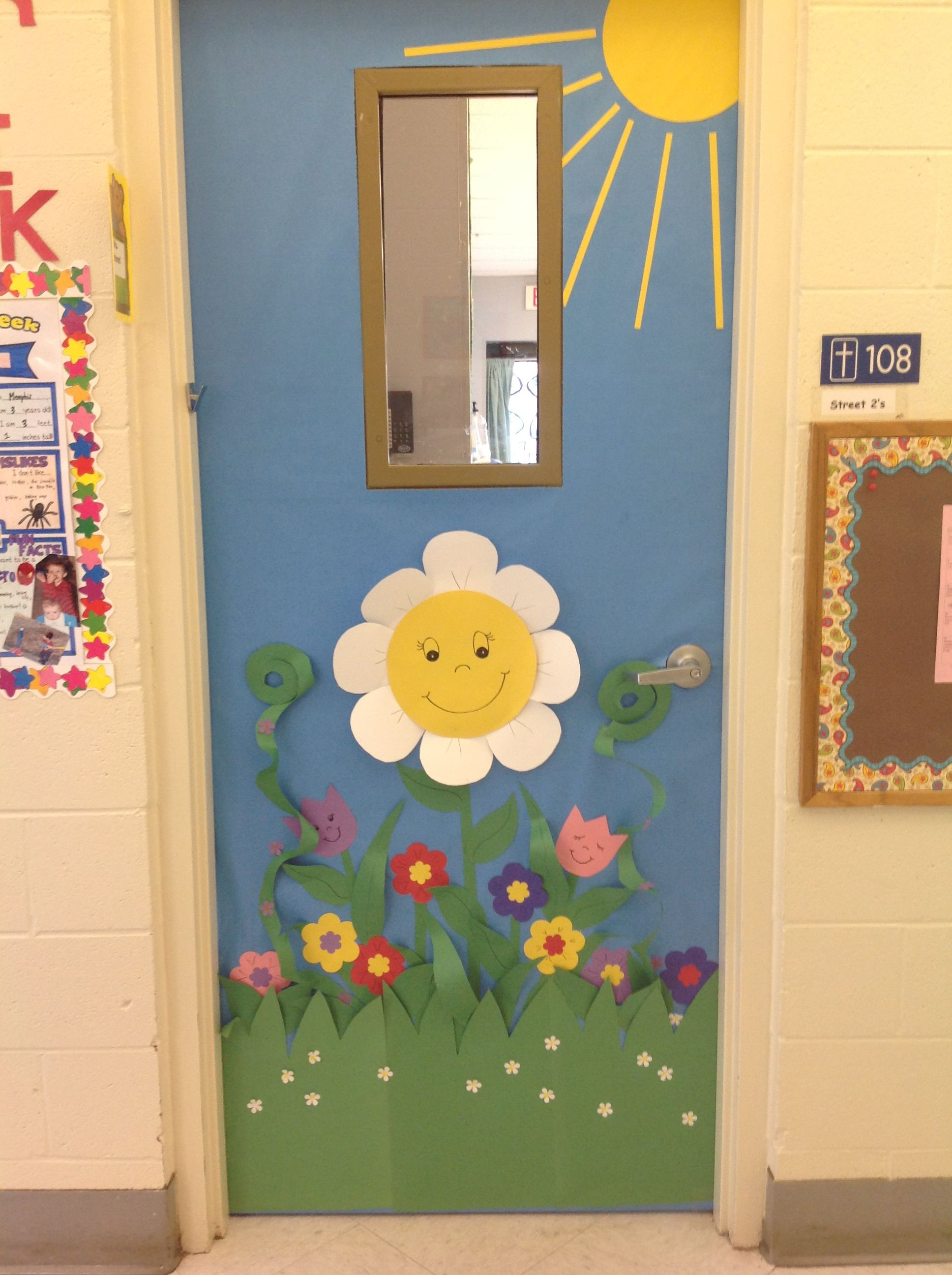 Spring classroom door idea a garden of happy flowers you for Nursery class door decoration
