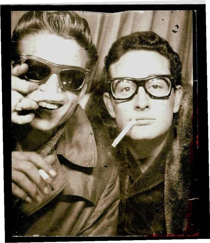 Waylon Jennings and Buddy Holly in a photo booth, Grand Central Station, New York City, 1959