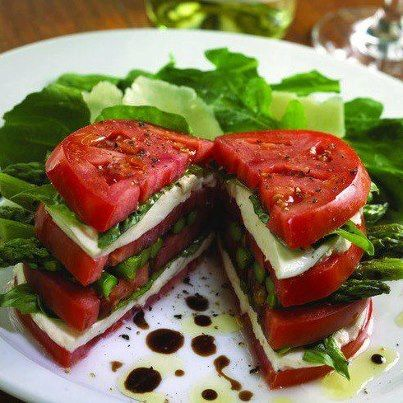 Just stack tomatoes, some mozzarella cheese, basil and asparagus and drizzle with some balsamic vinaigrette.
