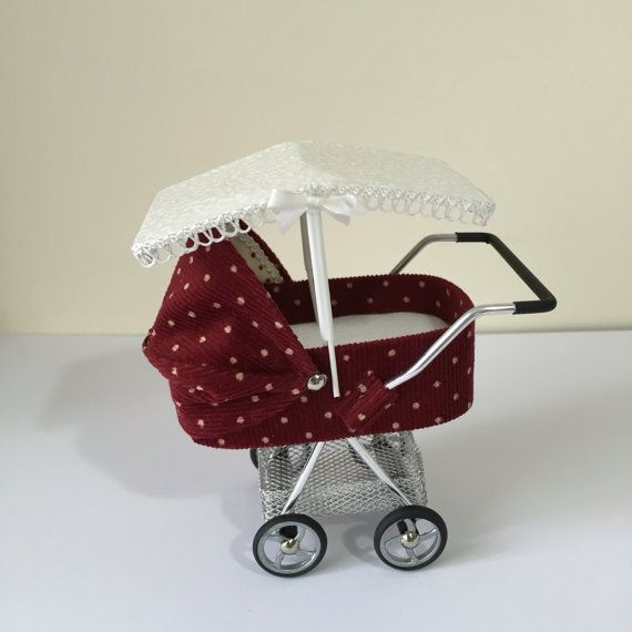 One canopy , designed to fit my prams see choice of ribbon colours, made in cram or white fabric PRAMS SHOWN IN THE PICTURES ARE NOT INCLUDED THEY ARE JUST FOR DISPLAY All my miniatures are hand made and designed by me.  available to post immediately   These Items are no longer sent signed for, so the shipping costs are mimimum  MY MINIATURES ARE FOR THE ADULT COLLECTOR, NOT TOYS AND ARE UNSUITABLE FOR CHILDREN UNDER 14
