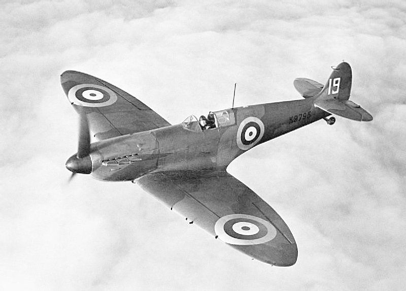 9th production Mk I Supermarine Spitfire, with 19 Squadron Royal Air Force, showing the wooden, two-blade, fixed-pitch propeller, early 'unblown' canopy and 'wraparound' windscreen without the bulletproof glass plate. The original style of aerial mast is also fitted.