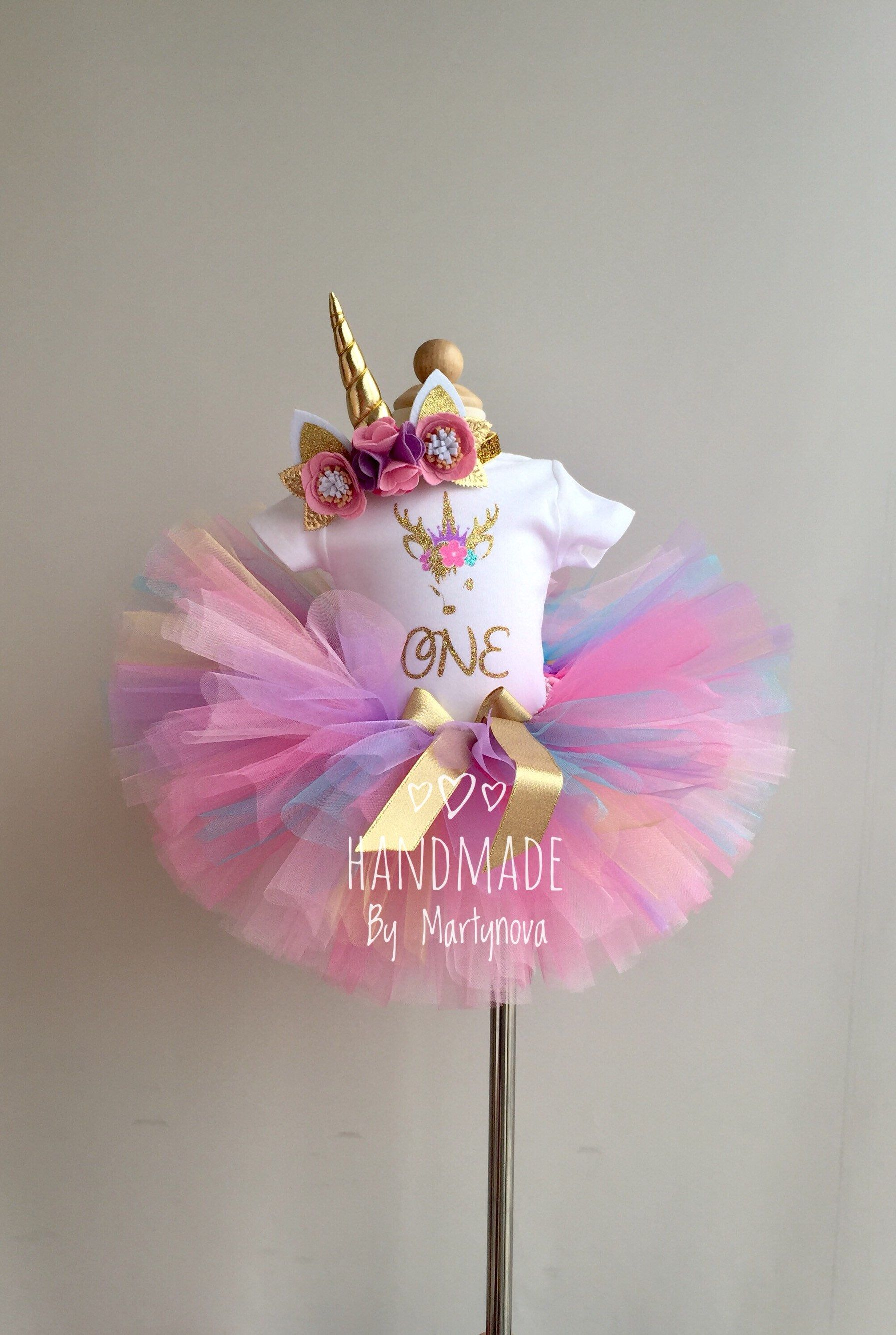 1st Birthday Outfit  Colored Tutu  Pink Tutu  Gold unicorn Horn  Unicorn birthday outfit  Smash cake outfit  Unicorn Headband  Flowers - Unicorn birthday outfit, 1st birthday outfits, Cake smash outfit, Unicorn headband, Birthday outfit, Unicorn birthday - 10% OFFER from $ 50  Code OFFER10 Dear Customers! ATTENTION PLEASE!!!  Before arranging the order please get acquainted with this 1  Please, specify the age of the child  2  If you choose the express delivery, then specify your contact phone number in a conversation or a note to seller at the checkout, without it, I will not be able to ship you a package  3  Processing time  After the placement of your order, I would need 35 BUSINESS days to make it, then it will be shipped  All parcels with standard delivery go by state mail of Turkey and respectively you receive them from state mail of the country  I' m shipping from Turkey to the address you provide to Etsy  Please fill out correctly  All orders are shipped by registered mail and you will be informed about the tracking number  Delivery time to Europe approximately 2 weeks by standard shipping Delivery time to USA approximately 23 weeks by standard shipping (rarely 4045 days in heavy Christmas season) It is not guaranty to get the orders on time for Christmas since the scarves ships from Turkey  The standard delivery takes 1530 days from Turkey to US in average due to postal servicecustoms workload  Rarely it takes 4045 days due to heavy Christmas traffic   The EXPRESS shipping takes 47 business days to US  If you have different questions, please contact me by Etsy Convo  Thank you very much!
