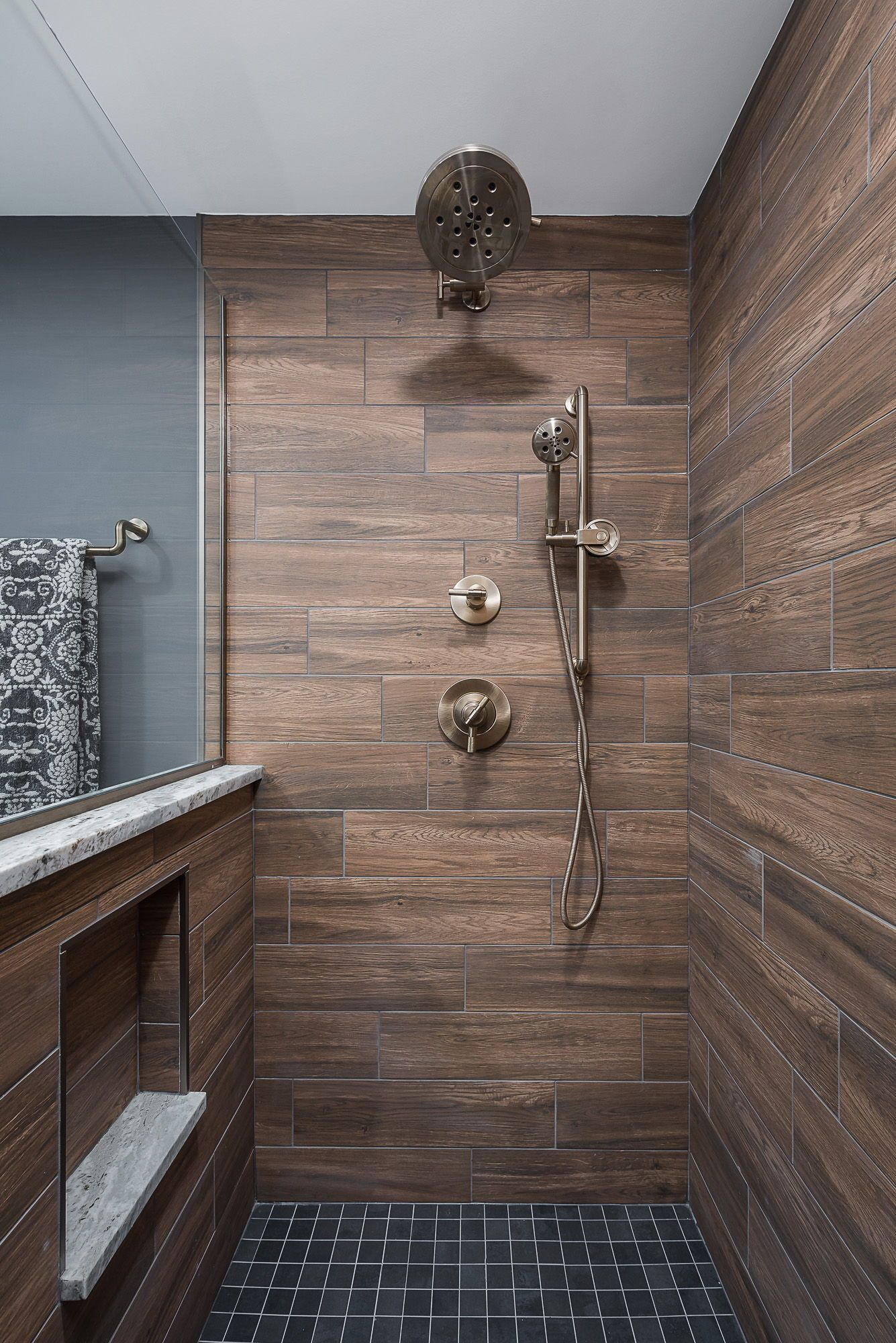 Add Character And Charm To Cool Toned Spaces By Mixing In Warm Elements Like This Wood Look Tile Wood Look Tile Bathroom Beautiful Tile Bathroom Wood Look Tile