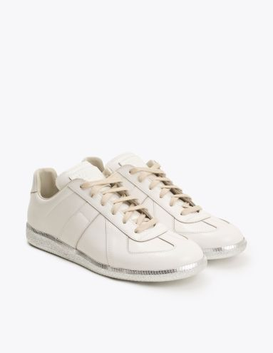 Sneakers from Maison Margiela. Leather upper with tonal stitching. Sewn on  patch logo on the tongue. Leather lining and insole.