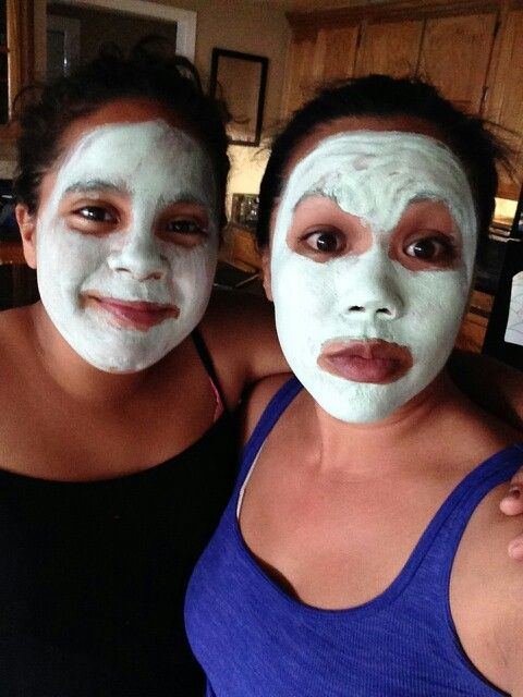My mom and i with our face stuff on.