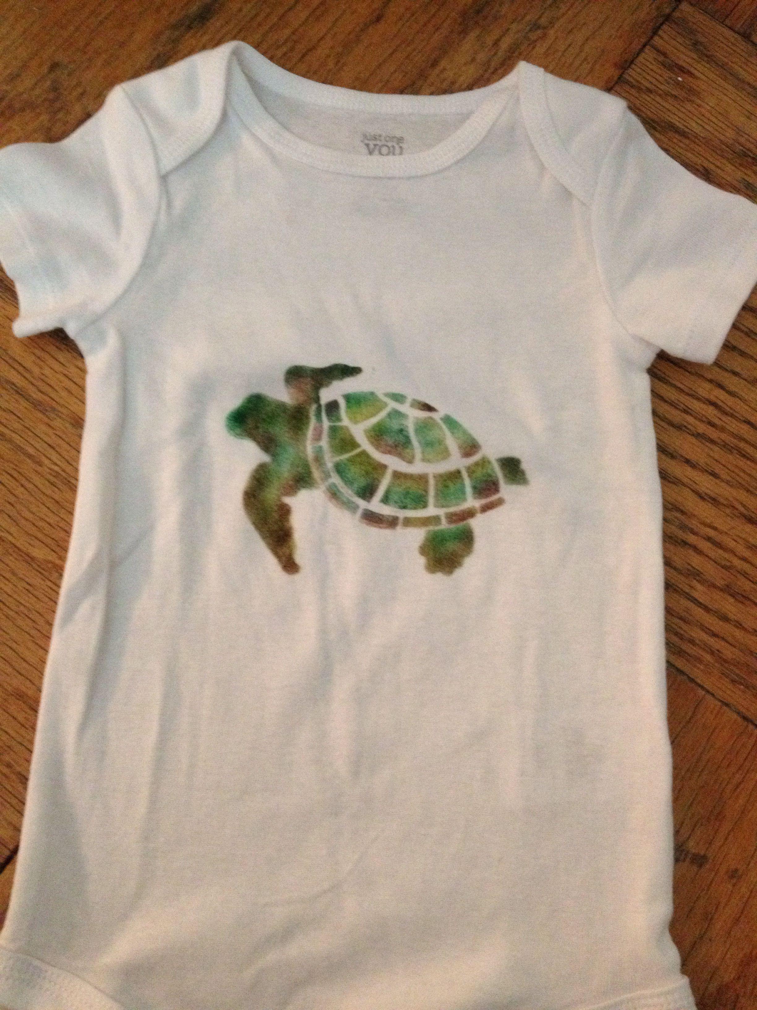 Stenciled sea turtle on onesie