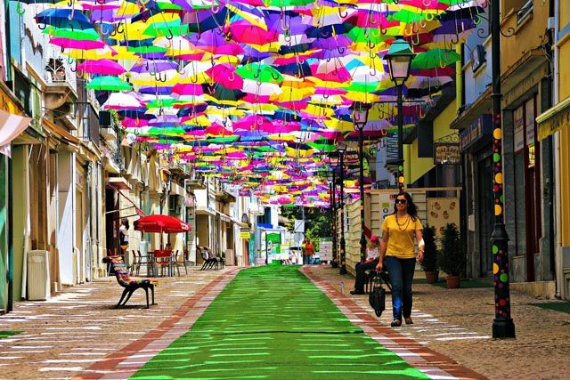 (via Canopies of Colorful Umbrellas and Beach Balls Cover Streets in Águeda, Portugal in a Month-Long Art Installation)