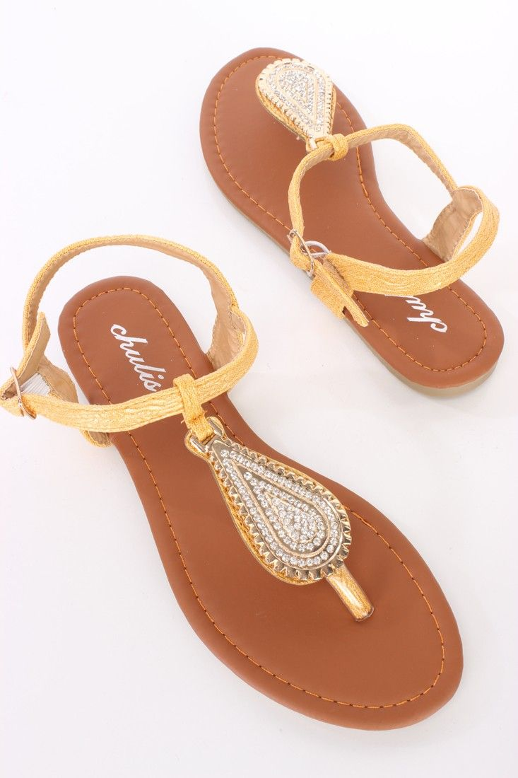 Be comfy yet stylish this season with these fashionable #sandals! They will go perfect with your favorite dress or skinnies! Make sure you add these to your closet, it definitely is a must have! The features for these #sandals include a faux #leather upper with a center teardrop shaped pendant and rhinestone detailing, thong post, side buckle closure, smooth lining, and cushioned foot bed.