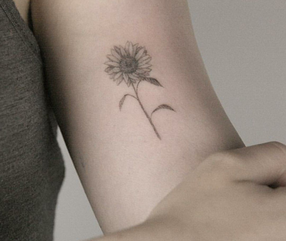 Photo of Dainty sunflower tattoo