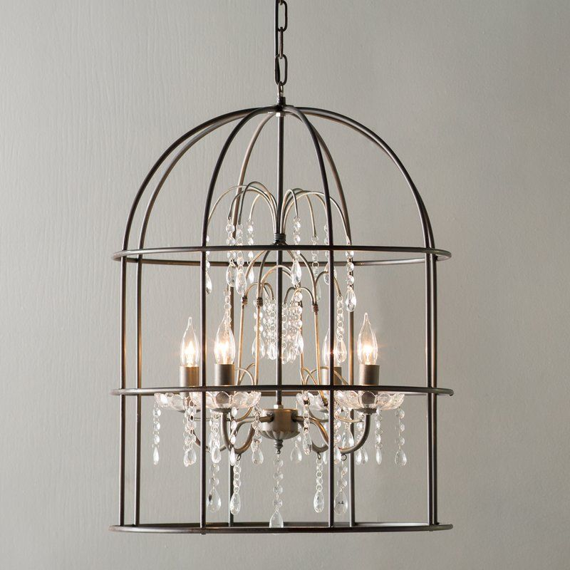 A birdcage shade houses this elegant four light chandelier defined a birdcage shade houses this elegant four light chandelier defined by its cascading crystal aloadofball Image collections