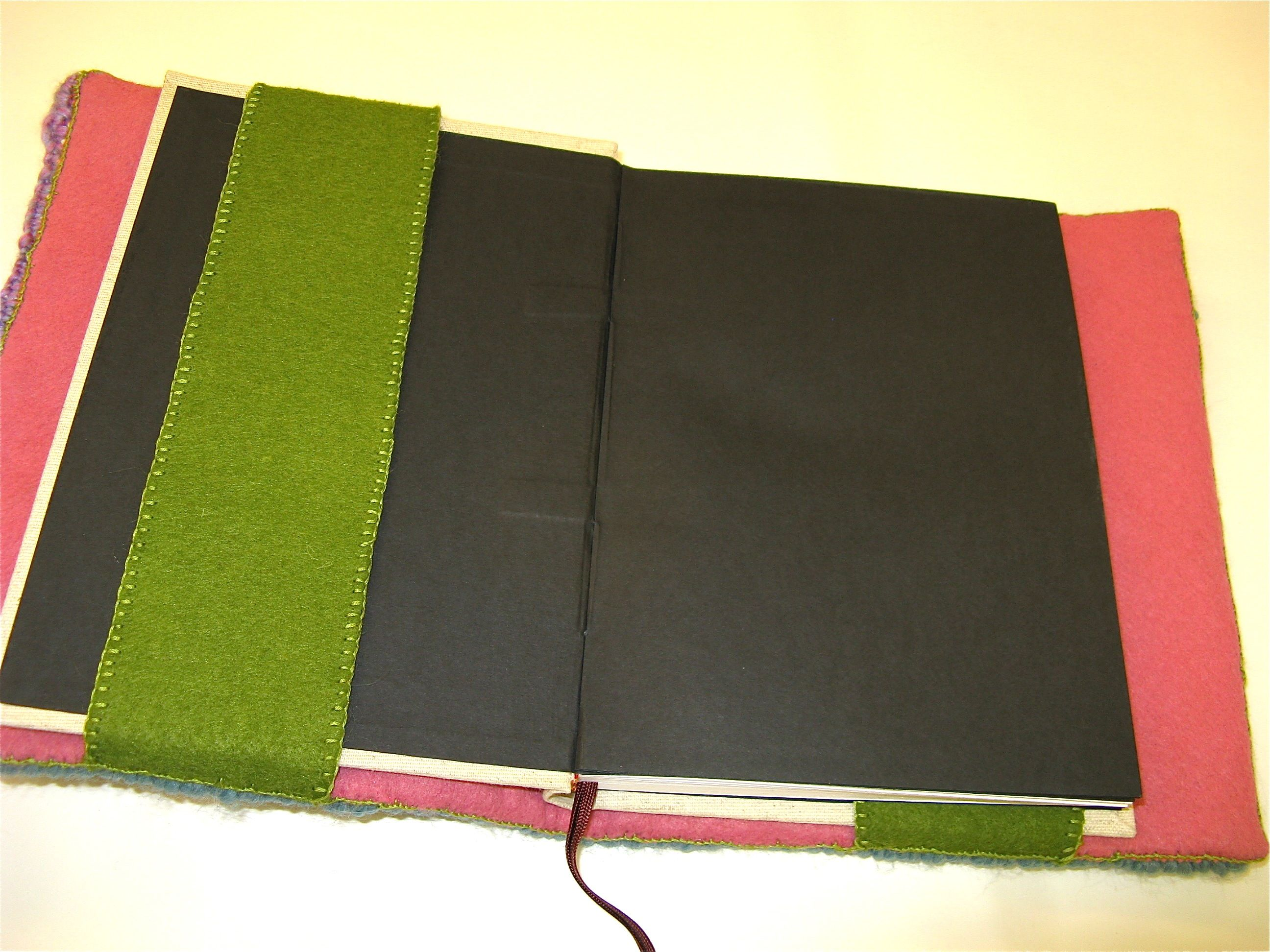 Hand hooked wool felt and yarn book slip on cover