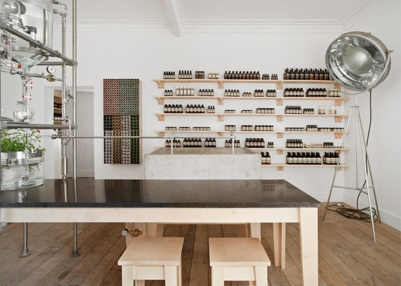 A complicated assemblage of glass beakers and steel tubes emits scents into this outpost of skincare brand Aesop.