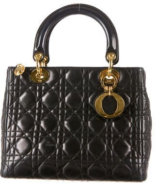 d9165fadc4 Black cannage leather Christian Dior Lady Dior Bag with gold-tone hardware,  logo charms, interior zipped wall pocket and top zip closure.