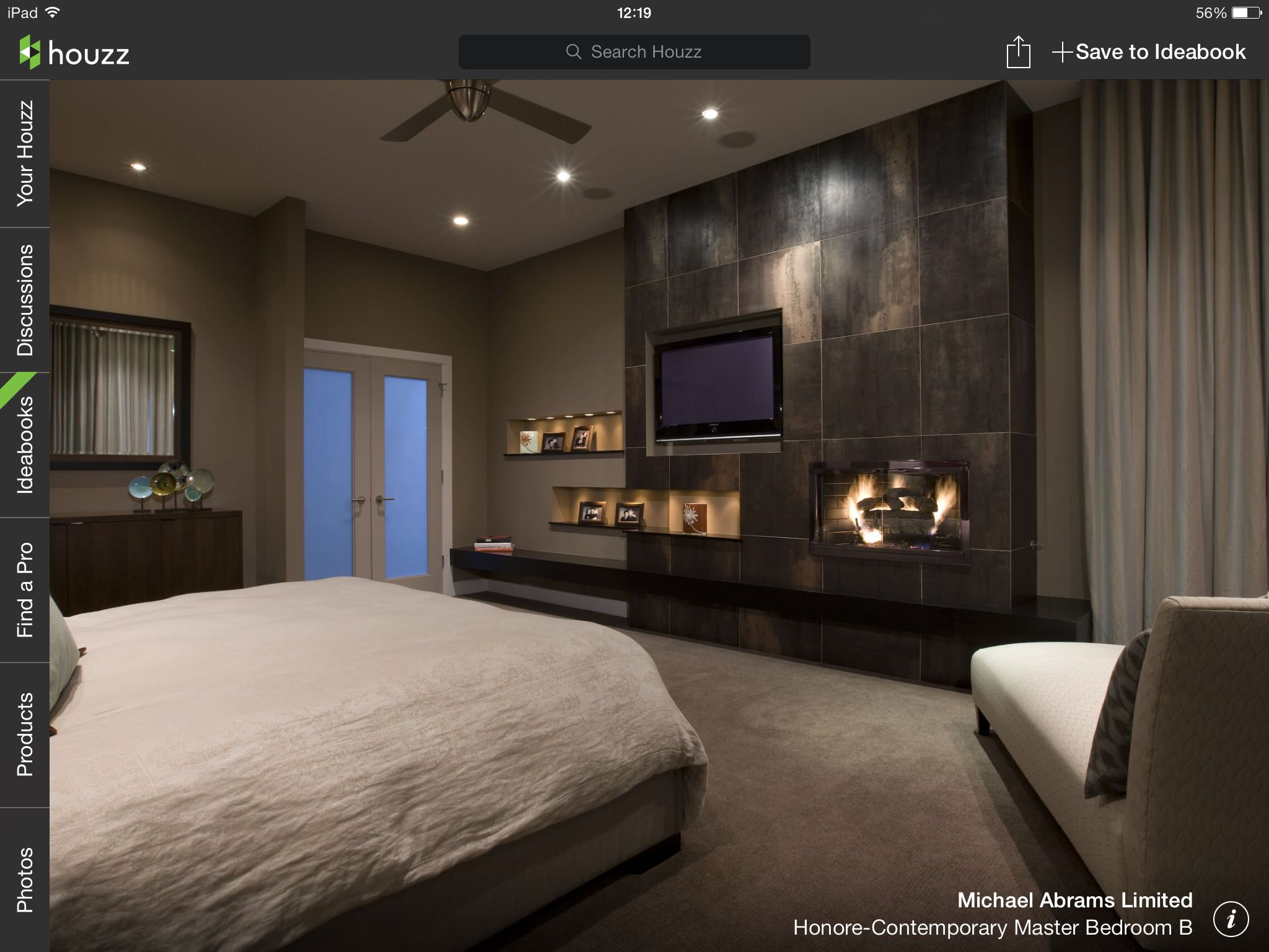 With feature wall tv and fireplace Contemporary bedroom
