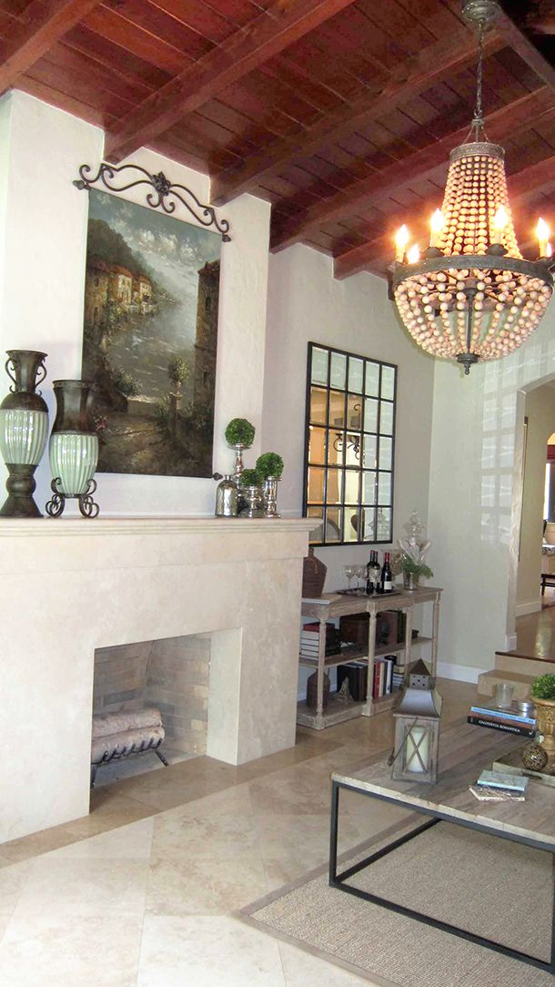 Living room features cathedral-beamed ceiling, fireplace, and chandelier 731 Minorca Avenue, Coral Gables, FL 33134 3 BR/2 BA $1,096,000. Call Jeannett Slesnick 305.975.8158 http://slesnick.net/listing/A1995143/
